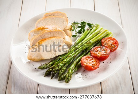 Roast chicken fillets and vegetables  - stock photo