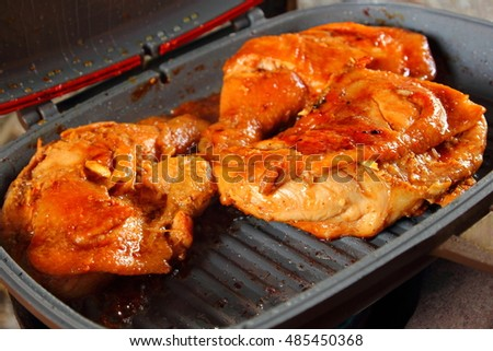 Roast chicken in the cooking pan