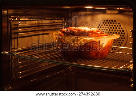 roast chicken in the oven cooking in the oven