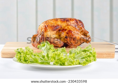 roast chicken is delicious on cutting boards with lettuce on plate