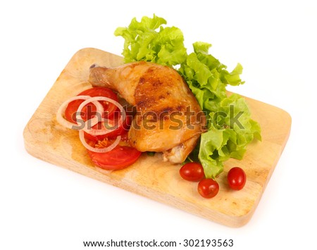 Roast chicken leg on cutting board isolated on white background