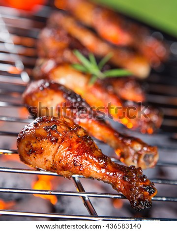 Roast chicken leg on grill. Garden barbegue.