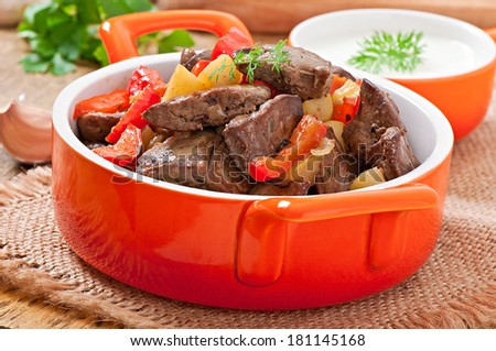 Roast chicken liver with vegetables - stock photo