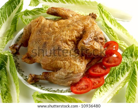 Roast Chicken on plate - stock photo