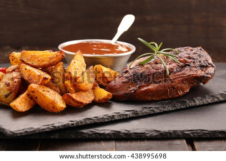Roast chicken portion with baked potatoes and dip    - stock photo