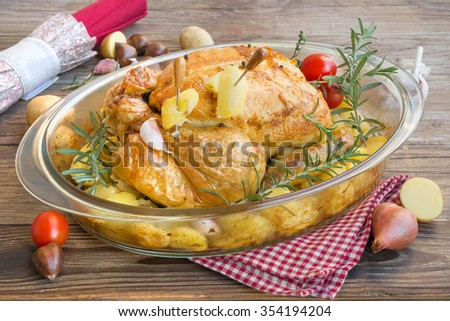 Roast chicken stuffed with potatoes and aromas