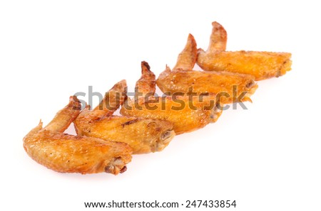 Roast chicken wings isolated on white background.
