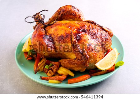 Roast chicken with lemon and honey glaze, served with chips and glazed carrot