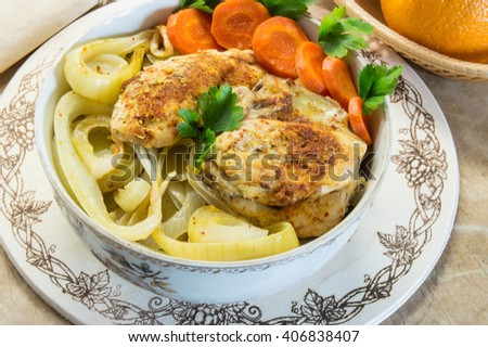 Roast chicken with potatoes carrots parsley and  fruits. It is made at home.  Rustic style.