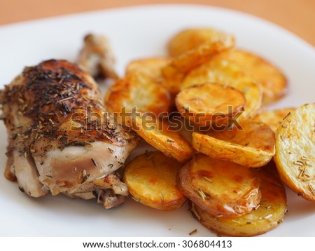 Roast chicken with rosemary and sliced baked potatoes