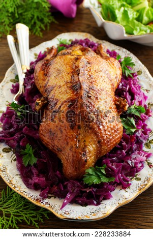Roast duck with apples and red cabbage.