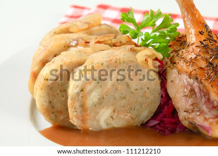 Roast duck with bread dumplings and red cabbage  - stock photo