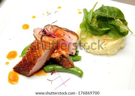 Roast duck with orange sauce - stock photo