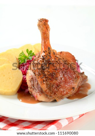 Roast duck with potato dumplings and red cabbage  - stock photo