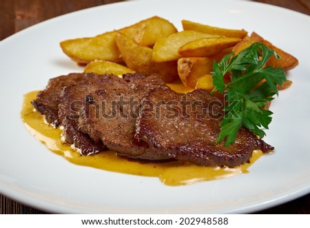 Roast fillet beef with potatoes. Shallow depth-of-field - stock photo