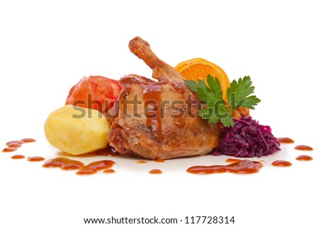 Roast goose leg with red cabbage and apples. - stock photo