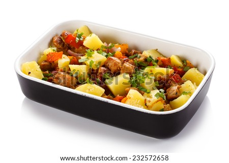 Roast meat with boiled potatoes and vegetables - stock photo