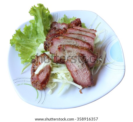 Roast pork beef and lettuce on a dish
