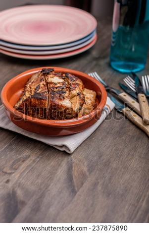 Roast pork in a bowl ready to be served - stock photo