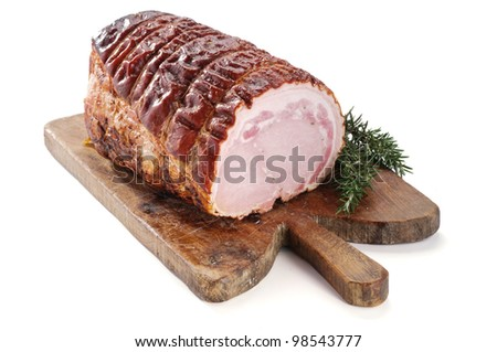 Roast pork on wooden board