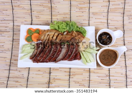 Roast pork , Roasted duck , Chinese style - stock photo