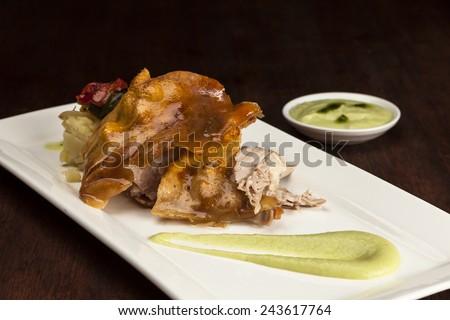 Roast pork with potatoes and apple sauce - stock photo