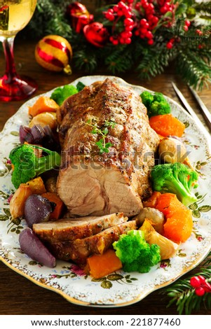Roast pork with vegetables and spices.