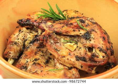 Roast rabbit cooked in herbs and garlic