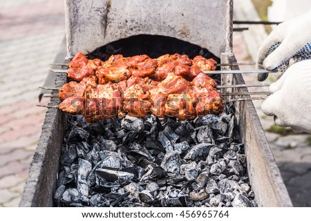 Roast the meat in the cooking process on the grill with grates and smoke. In the style of Oriental cuisine. - stock photo