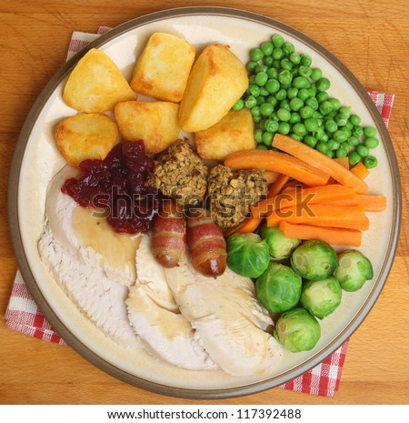 Roast turkey Christmas dinner with traditional trimmings. - stock photo