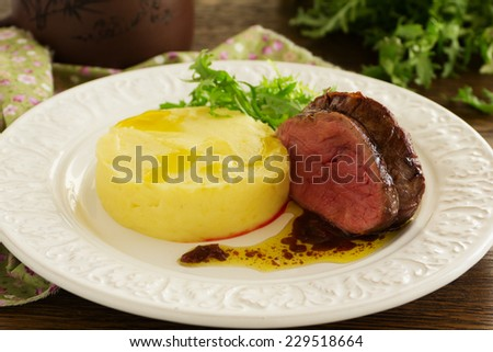 Roast veal with mashed potatoes and plum chutney. - stock photo