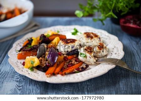 Roast  vegetable salad with mini turkey burgers - stock photo
