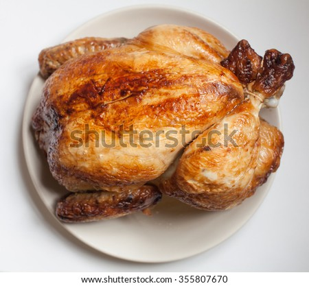 Roast whole chicken on a plate - stock photo