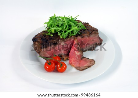 Roastbeef with gherkin and hot pepper on white background - stock photo