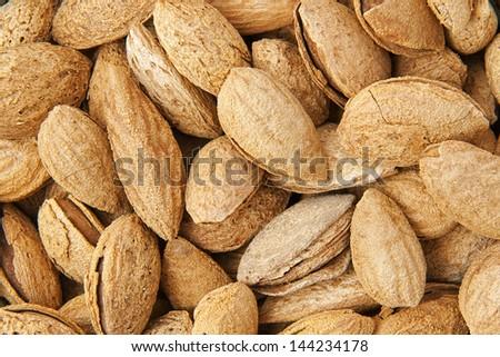 Roasted almonds background - stock photo