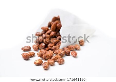 roasted almonds on white background - stock photo