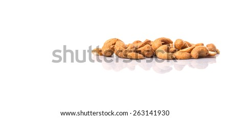 Roasted and salted cashew nut over white background - stock photo