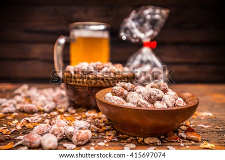 Roasted and salted peanuts in wooden bowl