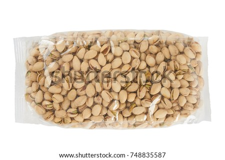 Roasted and salted pistachio nuts in transparent package isolated on white background.