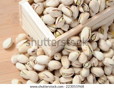 roasted and salty pistachio on the table - stock photo