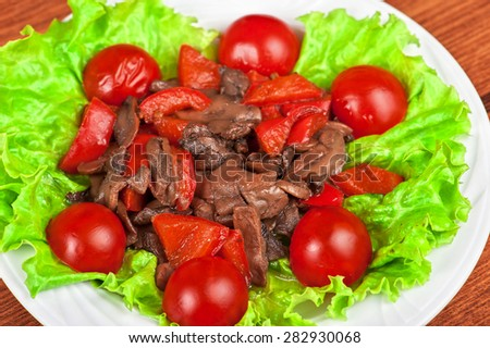 Roasted beef and mushrooms with tomato and lettuce - stock photo