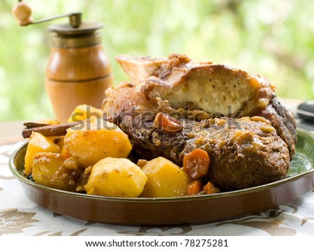 Roasted beef leg with potato and carrot. Selective focus