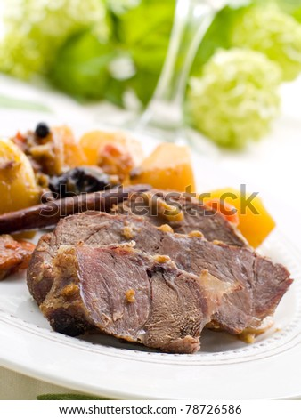 Roasted beef leg with potato and carrot. Selective focus - stock photo