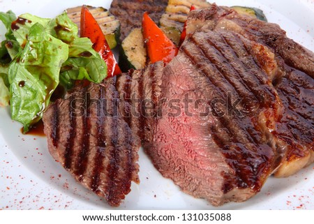 roasted beef steak on a white plate - stock photo