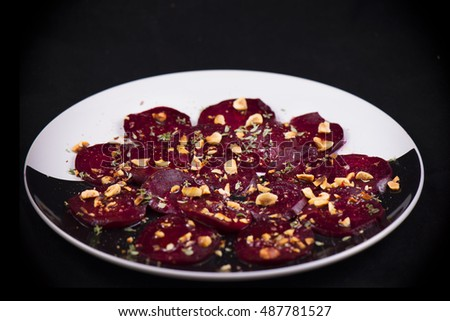 Roasted beet root salad with herbs and hazelnuts