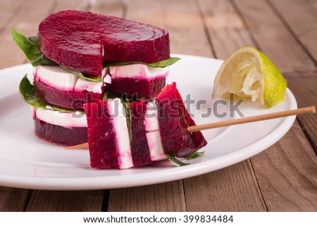 Roasted Beetroot and Feta Cheese with Olive Oil. Feta and Beet Stacks. Beet Salad on a stick.  Appetizer Recipe. - stock photo