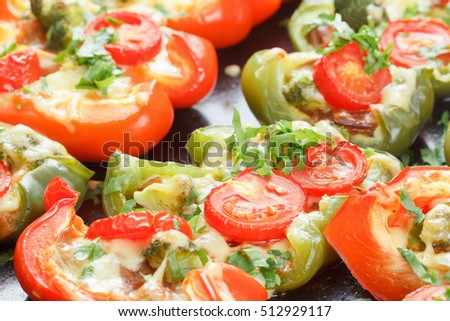 Roasted bell pepper with cheese, herbs and vegetables on a baking sheet. Cooking pizza pepper