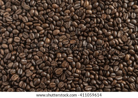 Roasted brown coffee beans background, above view - stock photo
