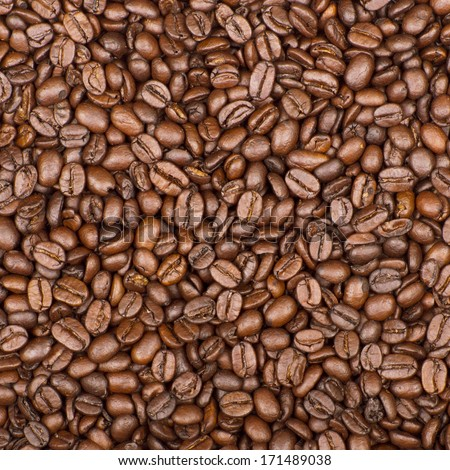 Roasted brown coffee beans, can be used as a background and texture - stock photo