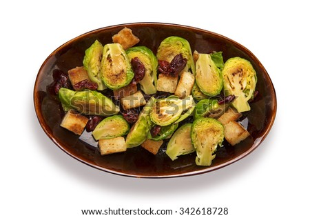 Roasted brussels sprouts with dried tomatoes and croutons isolated on white - stock photo